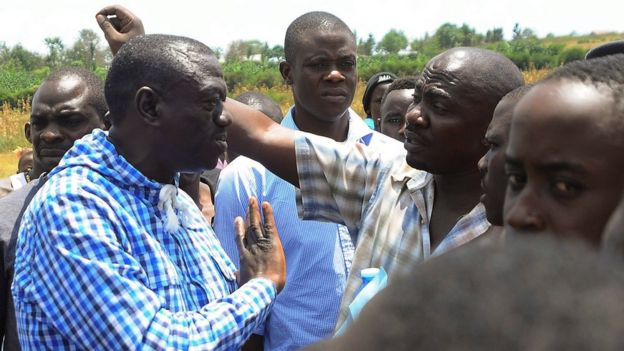 Ugandan opposition leader Kizza Besigye speaks to supporters during presidential elections