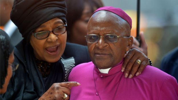 elson Mandela's former wife Winnie MadikizelaMandela speaks with South African Archbishop and Honorary Elders Desmond Tutu during the memorial service of South African former president Nelson Mandela at the FNB Stadium (Soccer City) in Johannesburg on December 10, 2013