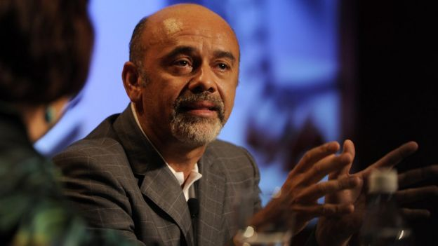 Christian Louboutin speaks at a forum on 10 November 2011