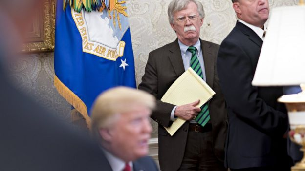 John Bolton, national security adviser, listens as President Trump speaks during a meeting in the Oval Office of the White House May 17, 2018
