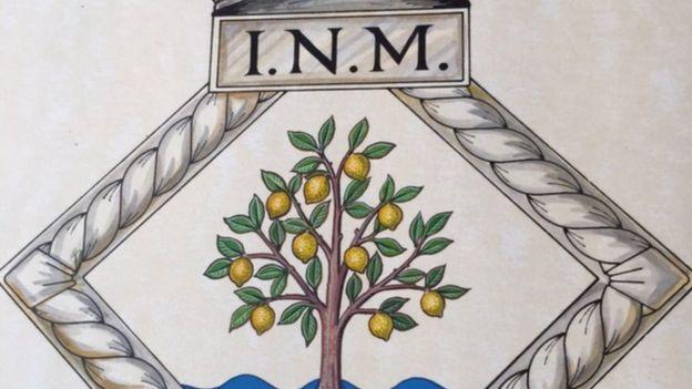 Escudo del INM