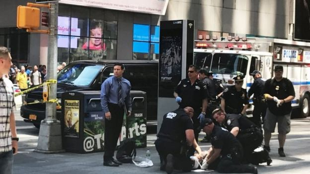First responders are assisting injured pedestrians after a vehicle struck pedestrians on a sidewalk in Times Square in New York.