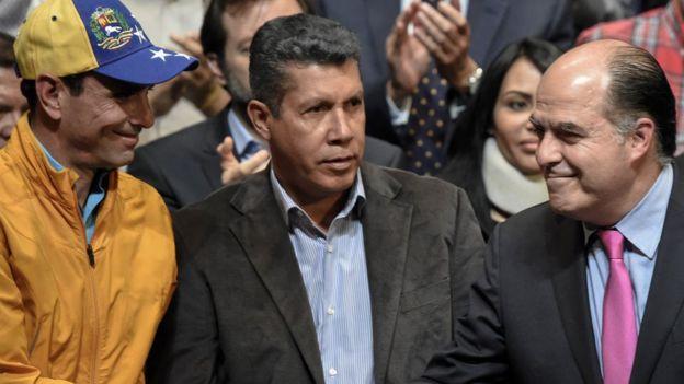 Henri Falcón (centro), Henrique Capriles y Julio Borges.