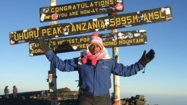 Magid Magid at the summit of Kilimanjaro