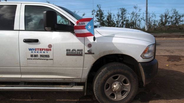 A truck with Whitefish Energy's logo and a Puerto Rican flag
