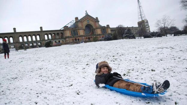 Nekko Sammann sledges in the snow at Alexandra Palace in north London, 17 January 2016.