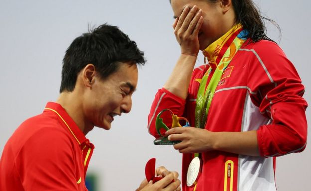 He Zi (CHN) of China recieves a marriage proposal from Olympic diver Qin Kai (CHN) of China after the medal ceremony.