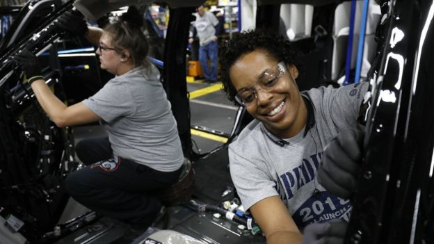 Ford workers Jasmine Powers (right) and Cassie Bell (left), install visors in the all-new 2018 Ford Expedition SUV at the Ford Kentucky Truck Plant October 27, 2017 in Louisville, Kentucky.