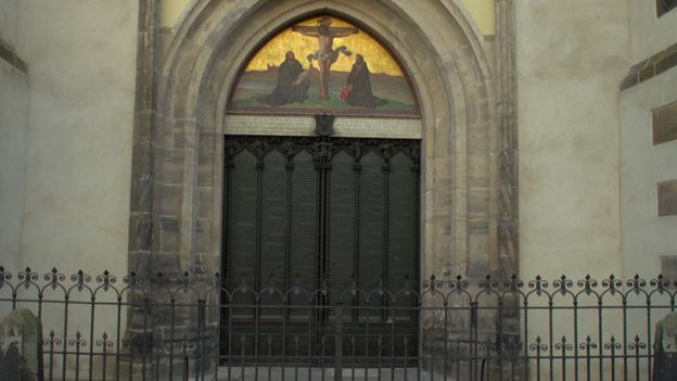 Heavy church doors with picture of Christ above