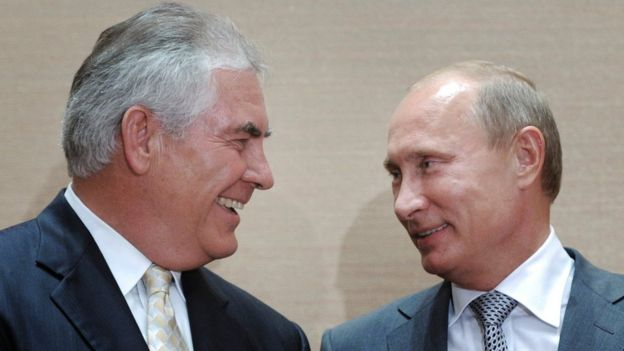 Russian Prime Minister Vladimir Putin, right, and Rex Tillerson, ExxonMobil