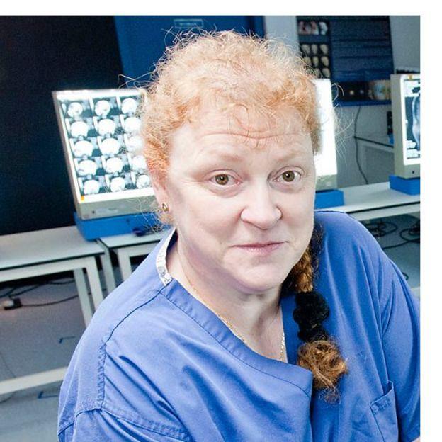 Professor Sue Black wearing scrubs