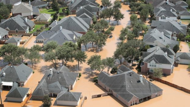 An aerial view shows an entire neighbourhood under several inches of murky brown water in Sugar land, south-east Texas