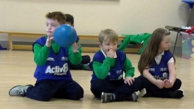 Primary school pupils sitting down