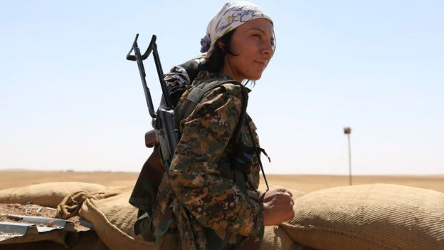 A female fighter from the Kurdish Popular Protection Units (YPG) on the frontline in Hassakeh, Syria (4 September 2015)