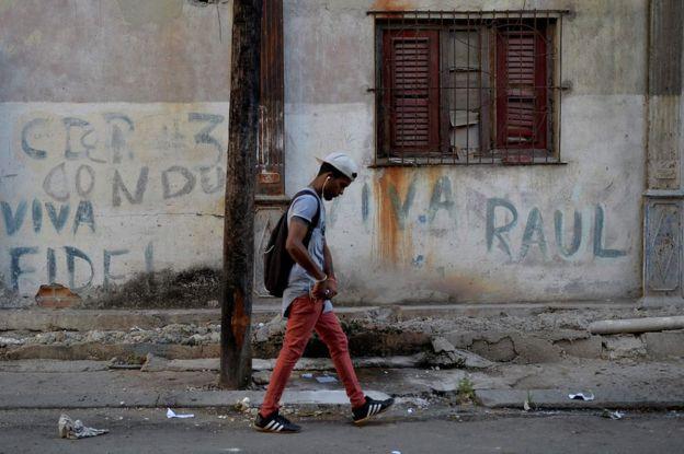 A man walks along a street in Havana, 18 April