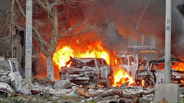 Wrecked cars burn at the scene of a terror attack at the Ambassador Hotel, Mogadishu, Somalia - Wednesday 1 June 2016