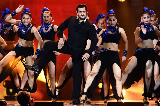 Salman Khan (C) performs on stage during an Indian film awards ceremony in New Jersey in 2017