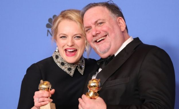 Actress Elisabeth Moss and producer Bruce Miller pose with the awards they won for The Handmaid's Tale