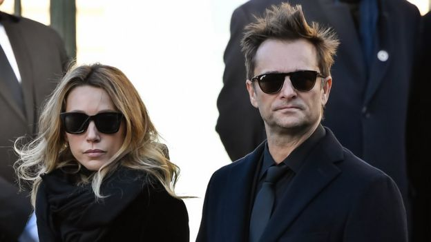 Laura Smet and son David Hallyday at late singer's funeral, wearing dark glasses