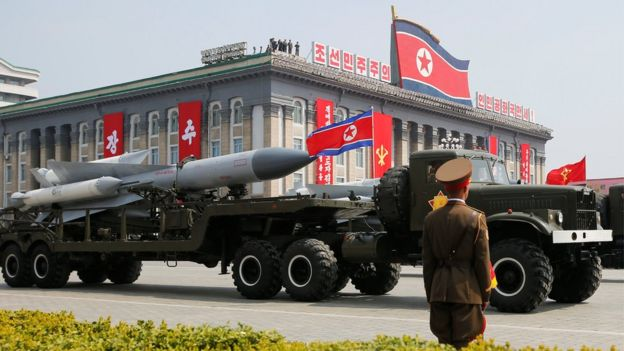 Missiles are driven past the stand with North Korean leader Kim Jong-un during a military parade marking the 105th birth anniversary of North Korea's founding father, Kim Il-sung, in Pyongyang, 15 April 2017