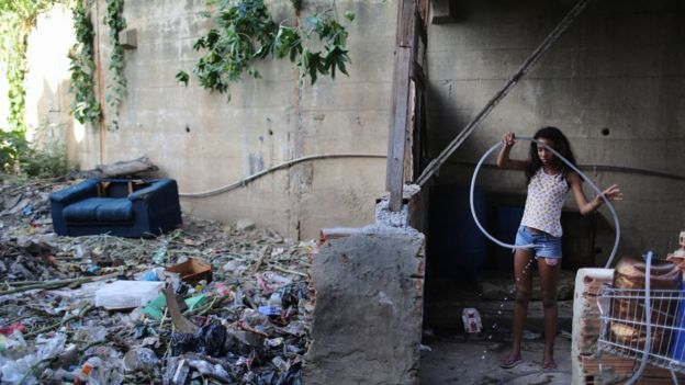 A Brazilian girl plays in an abandoned area.