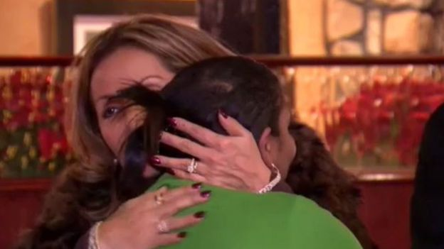 Customer hugging Ms Carter