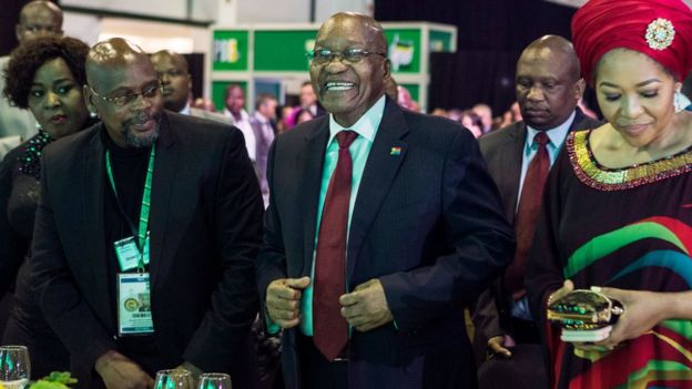 South African President Jacob Zuma (C) takes his seat during a presidential Gala dinner at the Nasrec Expo Centre in Johannesburg on December 15, 2017