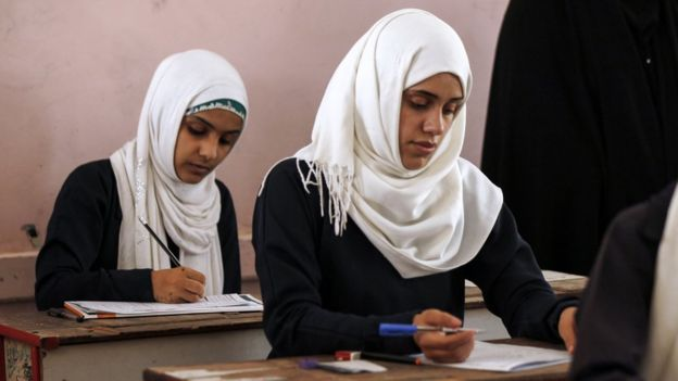 Female Yemeni students sit at a final exam in a secondary school in Sanaa