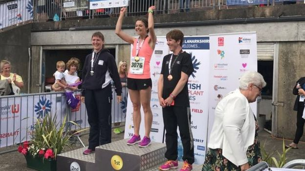 Ellie Lacey on the podium winning gold in the 800m at the British Transplant Games