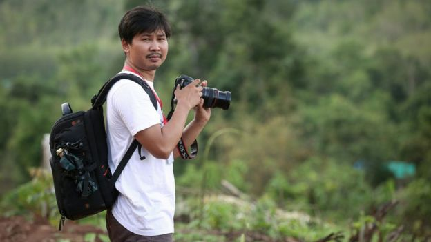 Reuters journalist Wa Lone at work with a camera
