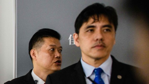 Jerry Chung Shing Lee (right), former CIA