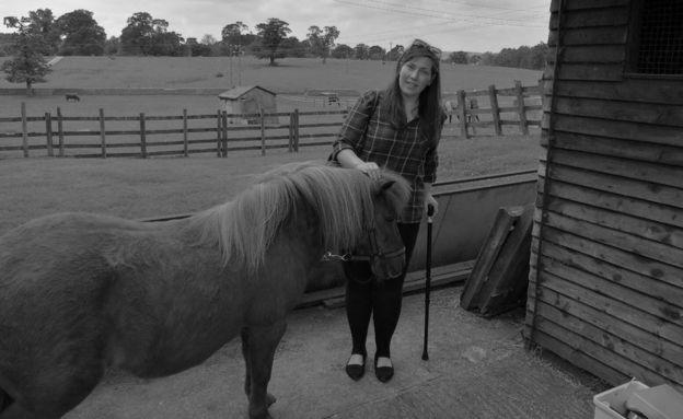 Alison com um cavalo