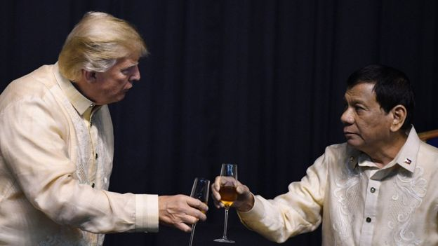 Philippine President Rodrigo Duterte (R) toasts US President Donald Trump during a special gala celebration dinner for the Association of Southeast Asian Nations (ASEAN) in Manila on November 12, 2017.