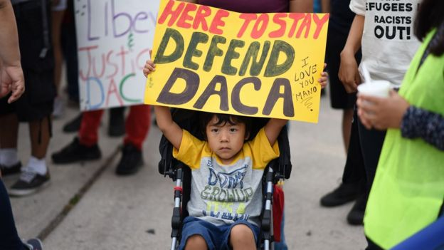 A child holds a pro-Daca sign at a protest in California.