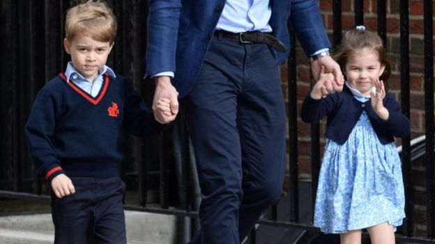 Princess Charlotte waves to the crowds and press outside the hospital