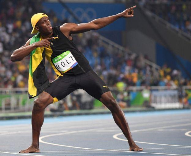 Usain Bolt en su pose de triunfo.