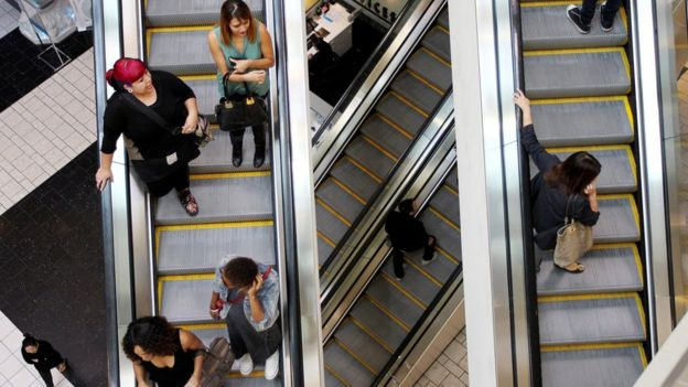 Shoppers on escalators