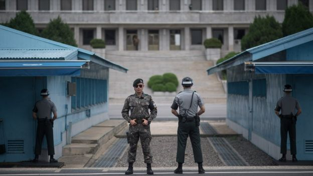 South Korean soldiers stand guard at the border village of Panmunjom in the Demilitarized Zone (DMZ) between South and North Korea on February 7, 2018 in Panmunjom
