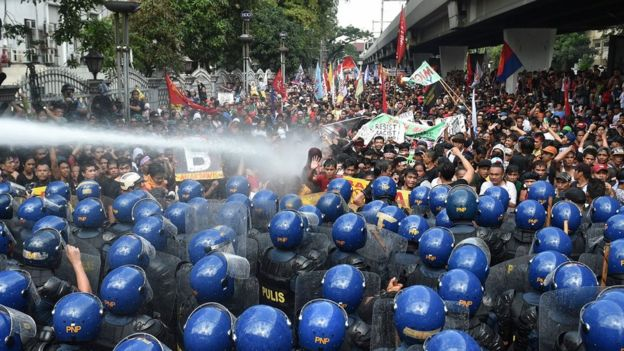 Riot police used water cannons to repel the protesters