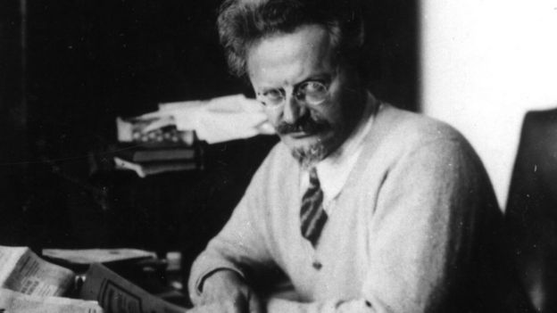 A black and white photograph of Leon Trotsky