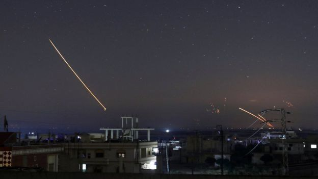 Syrian military air defence batteries lit up the night sky over the southern city of Deraa