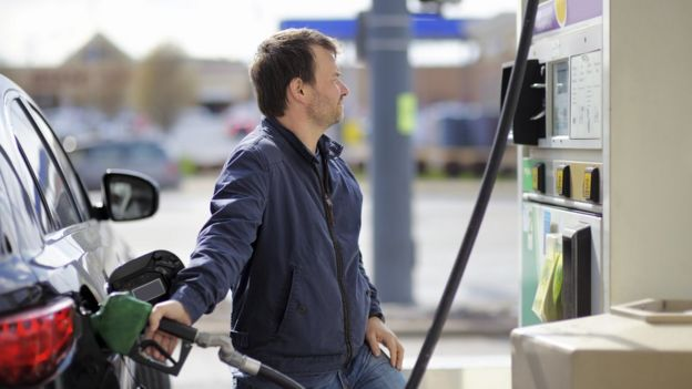 Man filling up petrol
