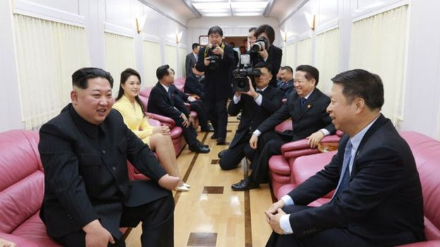 Kim Jong-un and his wife Ri Sol-ju meet officials aboard the North Korean leader's train