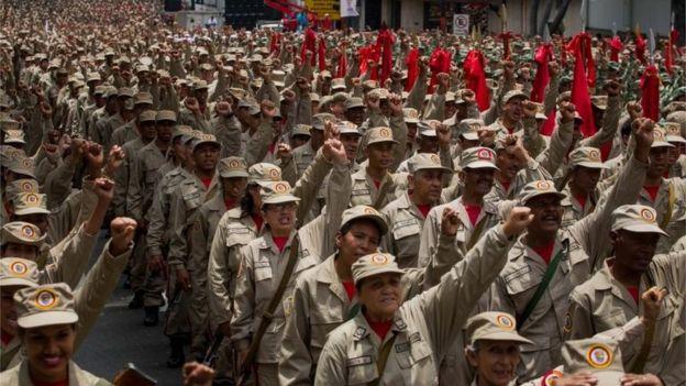 Militia members march to commemorate the seventh anniversary of the militia in Caracas, Venezuela, 17 April 2017.