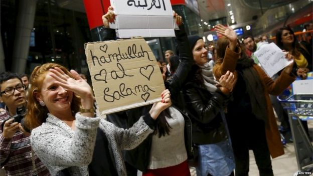 A welcome for migrants at Frankfurt Airport rail station, Germany, 6 September 2015