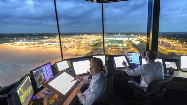 Controllers in the tower at Stansted Airport