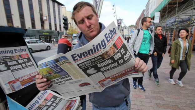 Man reading paper in Ireland