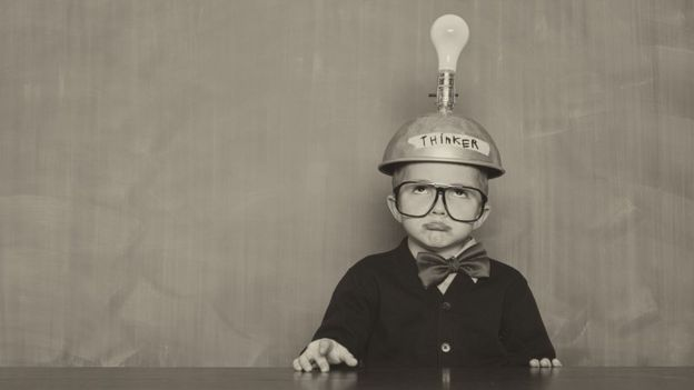 Stock image of a child with a lightbulb above their head