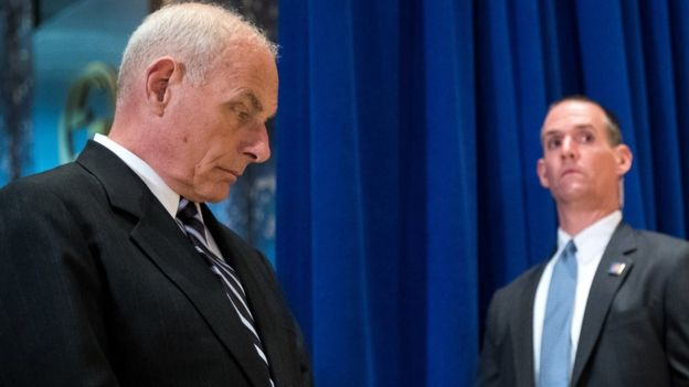 John Kelly (left) looks on as Trump holds his news conference in Trump Tower on 15 August 2017