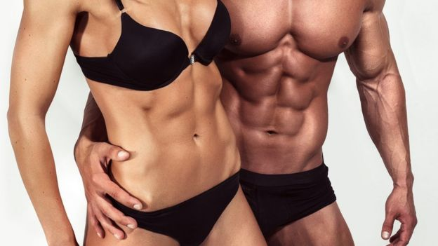 Woman and fit man with underwear